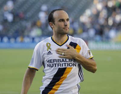 In this Sept. 11, 2016, file photo, Los Angeles Galaxy's Landon Donovan acknowledges fans after the team's MLS soccer match against Orlando City in Carson, Calif. (Jae C. Hong / Associated Press)