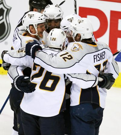 Nashville Predators players celebrate Ryan Suter's tying goal against the Vancouver Canucks at 18:53 of the third period. (Associated Press)