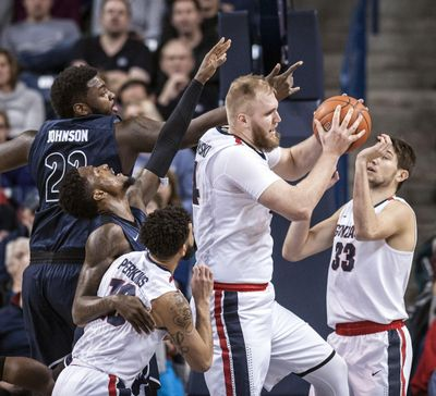 Gonzaga center Przemek Karnowski controls the boards against Akron on Dec. 10, 2016, in the McCarthey Athletic Center. (Dan Pelle / The Spokesman-Review)
