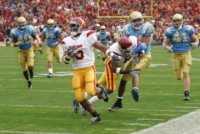 Southern California's Reggie Bush, shown running for a touchdown against UCLA last season, can score from anywhere on the field.  (Associated Press / The Spokesman-Review)