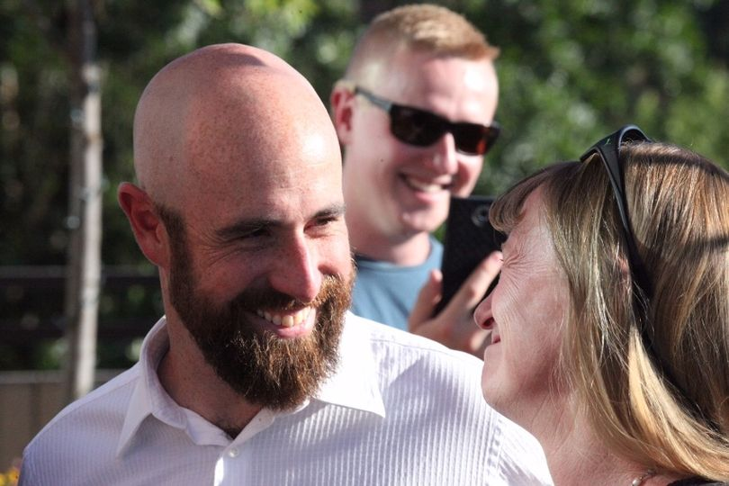 Luke Malek chats with his mother after his announcement that he's running for Congress. His brother is in the background. (Duane Rasmussen photo)