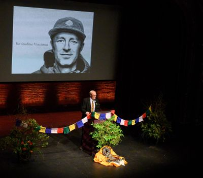John Roskelley, father of Spokane alpinist Jess Roskelley, speaks about the life of his son during packed memorial at the Bing Crosby Theater on Friday. (Colin Mulvany / The Spokesman-Review)