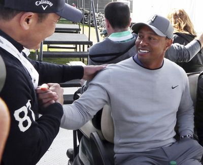 Tiger Woods greets a wellwisher after a news conference where he talked about his charitable works off the course and his return to competitive golf in the Genesis Open at Riviera Country Club after an absence of 12 years, at the course in the Pacific Palisades area of Los Angeles Tuesday, Feb. 13, 2018. (Reed Saxon / Associated Press)