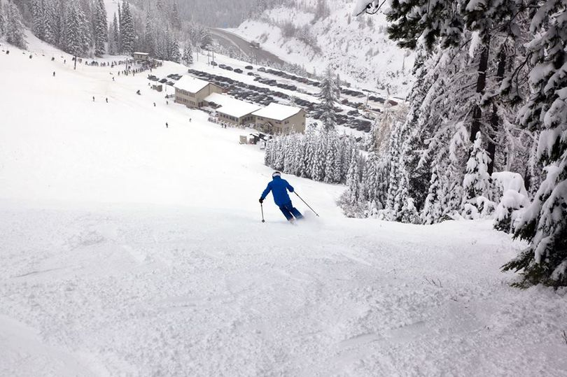 A skier finds plenty of whiteness as he heads down toward the lodge on Sunday at Lookout Pass Ski Area, the first in the region to open its lifts for the 2017-2018 season. (Lookout Pass Ski Area)