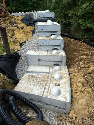 The giant precast-concrete retaining wall blocks stack and click together just like Lego blocks. (Tim Carter)