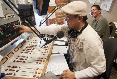 """Gabe Bylilly,  front, and Jeff Ferguson work on their Native American radio show  """"InnerTribal Beat"""" on Tuesday at the KYRS-FM studio in Spokane.  (Colin Mulvany / The Spokesman-Review)"""