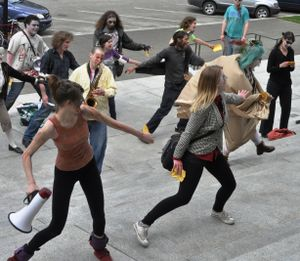 Protesters dressed as Zombies do a dance to protest budget cuts on the Capitol steps, May 13, 2011. (Jim Camden/The Spokesman-Review)