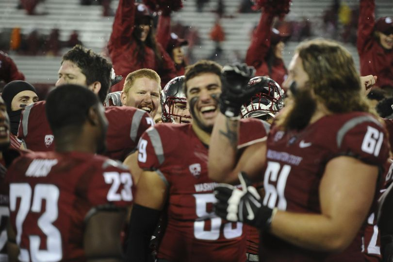 WSU celebrates after defeating UCLA during the second half of a Pac-12 college football game on Saturday, Oct. 15, 2016, Martin Stadium in Pullman. WSU won the game 27-21. (Tyler Tjomsland / The Spokesman-Review)