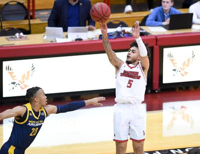 Eastern Washington Eagles guard Casson Rouse (5) shoots against the Northern Arizona Lumberjacks during a college basketball game on Saturday, February 22, 2020, at EWU in Cheney, Wash. (Tyler Tjomsland / The Spokesman-Review)