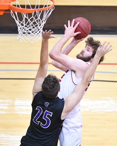 Eastern Washington Eagles forward Tanner Groves (35) drives to the hoop against the College of Idaho during the first half of a college basketball game on Friday, December 11, 2020, at Reese Court in Cheney, Wash.  (Tyler Tjomsland/THE SPOKESMAN-RE)