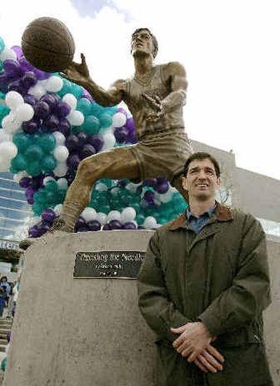 John Stockton poses with his statue in front of the Delta Center, home of Utah Jazz, in March 2005 in Salt Lake City.   (Associated Press / The Spokesman-Review)
