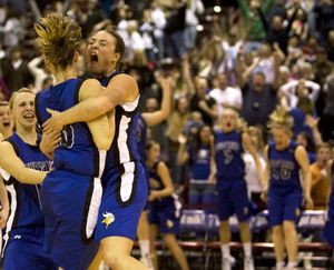 ORG XMIT: IDMC128 Coeur d' Alene's Kama Griffitts (10) and Whitney Heleker (30) celebrate their overtime win over Centential in the 5A Girls State Championship basketball game on Saturday, Feb. 21, 2009 in Nampa, Idaho.  Heleker hit a three-point shot to win the game with 1.7 seconds left on the clock.  Coeur d' Alene beat Centennial 54-50.  (AP Photo/Matt Cilley) (Matt Cilley / The Spokesman-Review)
