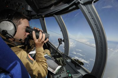 A French army air crewman  patrols the site of the crash Tuesday over the Atlantic Ocean.  (Associated Press / The Spokesman-Review)