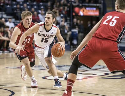 Gonzaga's Rem Bakamus drives against South Dakota's defense during a late-December game  in the McCarthey Athletic Center. (Dan Pelle / The Spokesman-Review)