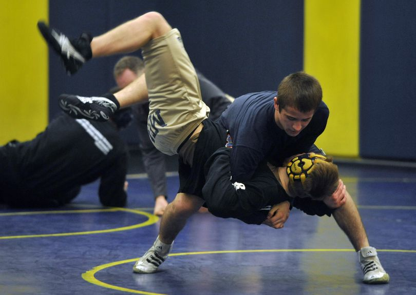 Mead wrestler, Jeremy Golding, takes down a teammate during practice. (Dan Pelle / The Spokesman-Review)