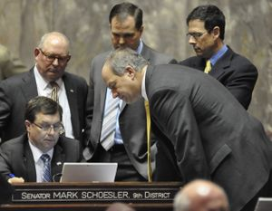 OLYMPIA -- Senate Republicans keep track of the vote on the supplemental budget, which eventually passed 27-17. Sen. Mark Schoesler, sitting at the desk, is surrounded by Sens. Mike Hewett, John Braun, Andy Hill and Steve O'Ban (left to right) (Jim Camden/The Spokesman-Review)