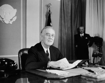 President Franklin D. Roosevelt speaks before a nationwide audience on Nov. 14, 1944, from the East Room of the White House on the eve of the Sixth War Loan campaign to urge people to buy more war bonds.  (Henry Burroughs)