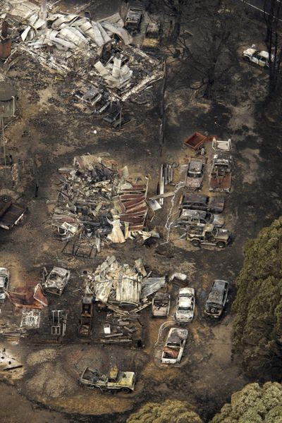 Buildings and vehicles sit destroyed at Kinglake, northeast of Melbourne, Australia, on Sunday.  (Associated Press / The Spokesman-Review)