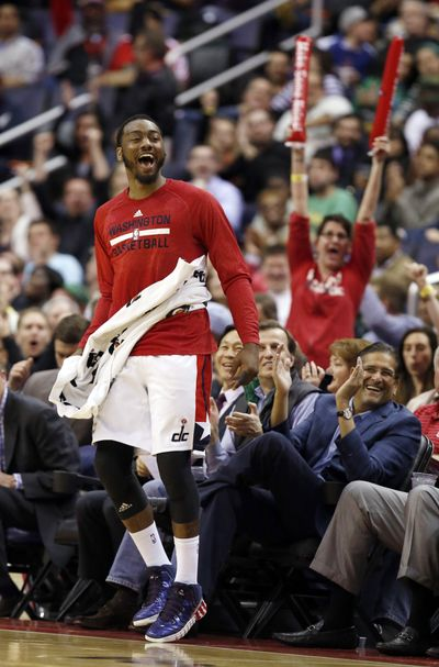Washington Wizards guard John Wall celebrates near the bench during the second half against the Boston Celtics. (Associated Press)