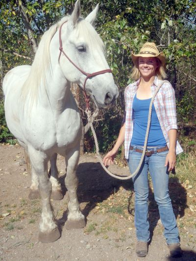 Erin Bolster, a wrangler for Swan Mountain Outfitters near Glacier Park, poses with her horse, Tonk.