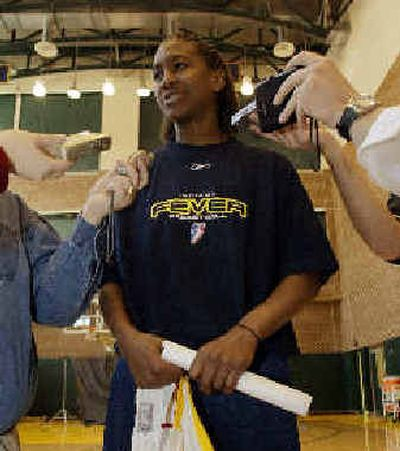 Indiana's Tamika Catchings meets the press. Indiana's Tamika Catchings meets the press.   (Associated PressAssociated Press / The Spokesman-Review)