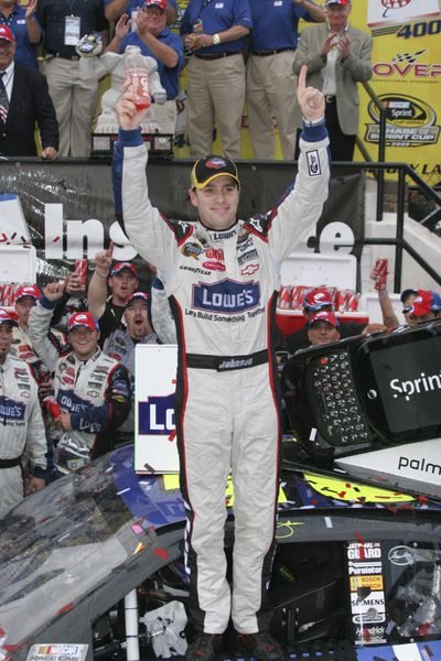 Jimmie Johnson celebrates his second win at Dover this season. (Associated Press / The Spokesman-Review)
