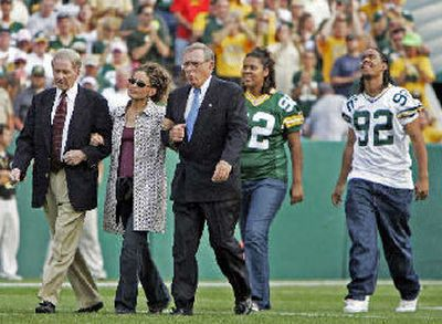 Sara White, widow of Reggie White, is flanked by Packers president Bob Harland, left, and former GM Ron Wolf.  (Associated Press / The Spokesman-Review)