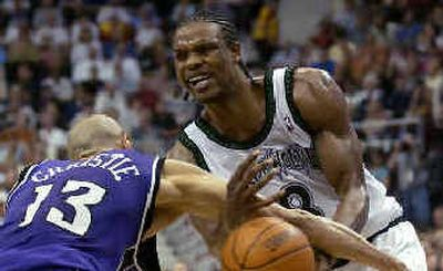 Kings' Doug Christie (13) strips the ball from Latrell Sprewell.  (Associated Press / The Spokesman-Review)