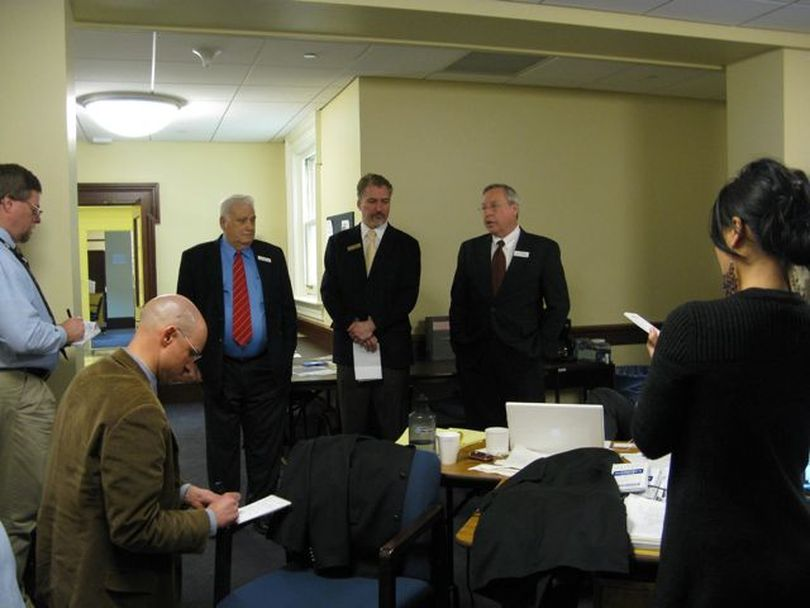 Senate Commerce Chairman John Andreason, R-Boise, left, and Senate Assistant Majority Leader Joe Stegner, R-Lewiston, right, brief reporters along with Senate GOP spokesman Phil Hardy, center, about the decision Tuesday morning to cancel a scheduled 1:30 hearing on HCR 42, a bill to block a COLA for state retirees. The cancellation means the bill is dead, and retirees will get their scheduled 1 percent COLA. (Betsy Russell)
