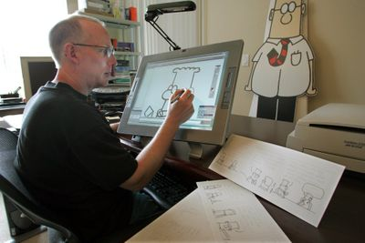 "As ""Dilbert,"" created by Scott Adams, celebrates its 20th anniversary, it's riding a resurgence thanks to corporate America's economic woes. In February, the comic strip's Web site logged 1.5 million visitors, one of its busiest months ever. Adams, right, works in his home in Dublin, Calif.The Washington Post (File The Washington Post / The Spokesman-Review)"