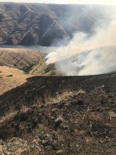 The Snake River wildfire started by lightning early Saturday morning was 20 percent contained as of Monday. (Washington Department of Natural Resources / Courtesy photo)