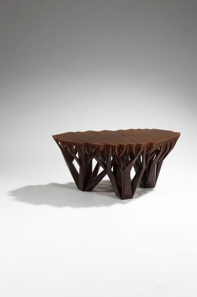 The Fractal.MGX coffee table by WertelOberfell, made from a brown epoxy resin, was designed after the growth patterns of trees. (Associated Press)
