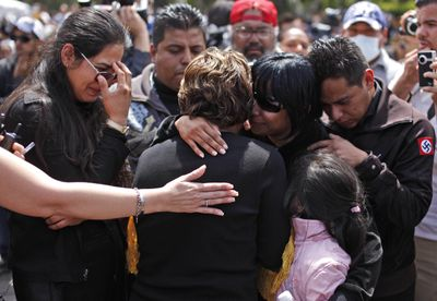 Relatives of one  of seven police officers killed Monday react  at a funeral service in Tijuana, Mexico, on Thursday. The  officers were assassinated in  what authorities said  was a coordinated effort.  (Associated Press / The Spokesman-Review)