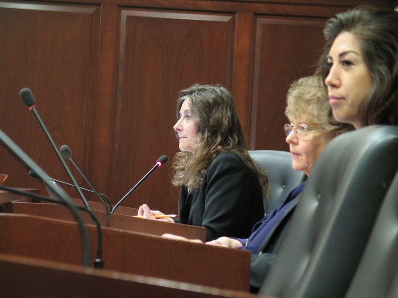 From left, Idaho Reps. Heather Scott, R-Blanchard; Elaine Smith, D-Pocatello; and Paulette Jordan, D-Plummer, consider a proposed financial disclosure bill in the House State Affairs Committee on Wednesday, Jan. 17, 2018. (Betsy Z. Russell)