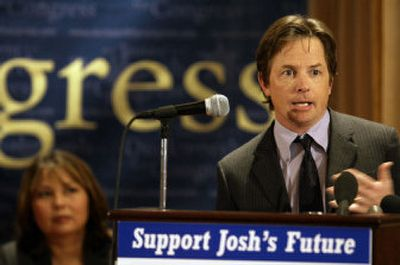 Actor Michael J. Fox joins Tammy Duckworth, the Democratic candidate for the U.S. House in Illinois' 6th Congressional District, during a rally for stem cell research Tuesday in Wheaton, Ill.   (Associated Press / The Spokesman-Review)