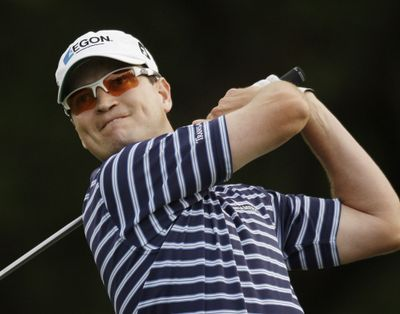 Zach Johnson watches his tee shot on the 18th hole during the third round of the Texas Open. He shot 60 on Saturday, matching the course record. (Associated Press / The Spokesman-Review)