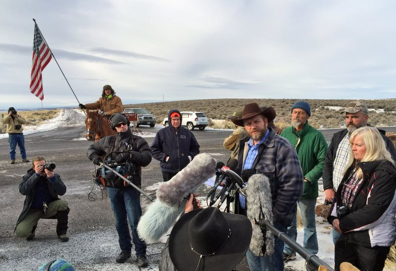 Ammon Bundy speaks to reporters at the Malheur National Wildlife Refuge in Burns, Ore., on Thursday, Jan. 14, 2016. Bundy is the leader of a small, armed group that has been occupying the remote refuge in Oregon since Jan. 2 to protest federal land policies.  (Keith Ridler / Associated Press)
