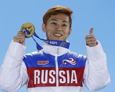 Men's 1,000-meter short track speedskating gold medalist Viktor Ahn, of Russia, gestures while holding his medal during the medals ceremony at the 2014 Winter Olympics in Sochi, Russia. Sports highest court rejected appeals by all 45 Russian athletes plus two coaches who were banned from the Pyeongchang Olympics over doping concerns in a decision announced Friday, Feb. 9, 2018, less than nine hours before the opening ceremony. Among those excluded are six-time gold medalist Ahn, the short track speedskater whose return to his native South Korea for the Olympics had been hotly anticipated by local fans. (David J. Phillip / Associated Press)