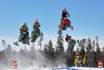 Stunt riders perform at the annual Snowmobile Expo in West Yellowstone, Mont. Courtesy of World Snowmobile (Courtesy of World Snowmobile / The Spokesman-Review)