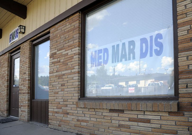 From this Spokane Valley strip mall  Paul  Ellis sold medical marijuana until he was busted by the Spokane Sheriff's department recently. In the window is reflected a WSP office across the parking lot. Photographed Tuesday, Sept. 14, 2010. (Jesse Tinsley / The Spokesman-Review)