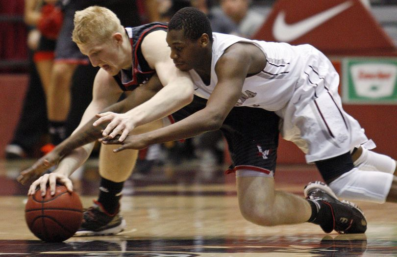 EWU's Bogdan Bliznyuk, left, steals ball from UM's Mario Dunn. (Associated Press)