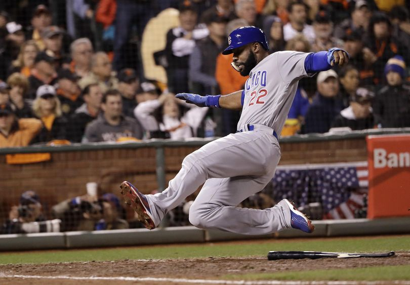 Chicago Cubs' Jason Heyward scores against the San Francisco Giants during the ninth inning of Game 4 of baseball's National League Division Series in San Francisco on Tuesday. (Marcio Jose Sanchez / Associated Press)