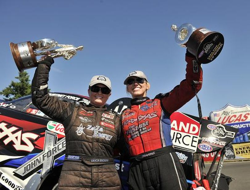 Erica Enders (l) and Courtney Force celebrate victories in Seattle on the NHRA Full Throttle Drag Racing Series. (Photo courtesy of NHRA)