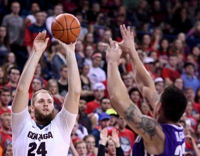 Gonzaga center Przemek Karnowski already knew what it felt like to be top dogs. (Colin Mulvany / The Spokesman-Review)