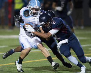 Central Valley wide receiver P.J.Bowden, left, is tackled by Mt. Spokane defensive back Stu Stiles during the first half of their GSL high school football game, Thursday, Sept.19, 2013, at Joe Albi Stadium. (Colin Mulvany / The Spokesman-Review)