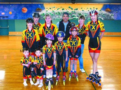 The Akana family, most of whom are in the inline skating group Team X, includes parents Stacy and Roni Akana, back row center and center right, and kids Natasha, 12, twins Zakayla and Xalia, 2, Zephaneah, 14, Stephanie, 19, Annastasiah, 4, Neahmiah, 6, Makailah, 9, Zemikah, 7 months, and Xion, 16.  One other son, Scott, is in the Marines and serving overseas.   (JESSE TINSLEY Photos / The Spokesman-Review)