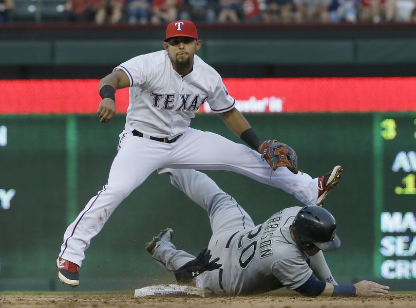 Seattle Mariners Logan Morrison, right, slides into second base trying the break up the double play against Texas Rangers second baseman Rougned Odor, left, during the second inning of a baseball game in Arlington, Texas, Monday. Mariners Mike Zunino was out at first.  (Associated Press)