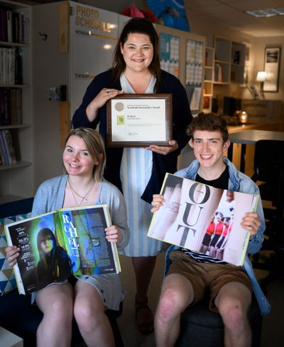 The Mead High School yearbook staff was named a Pacemaker Finalist by the National Scholastic Press Association. Pictured is yearbook adviser Makena Busch (behind), student and Editor-in-Chief Isabella Wood, 18, and Photo Editor Daniel Jarvis, 18. (Colin Mulvany / The Spokesman-Review)