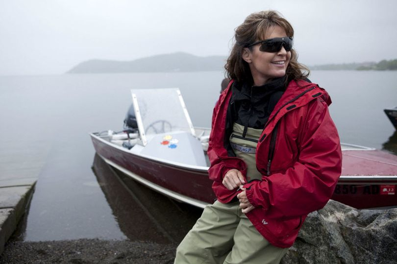 Sarah Palin sits next her husband Todd's boat in Dillingham, Alaska, in July 2010 as part of a documentary for the TLC channel.  (Associated Press)