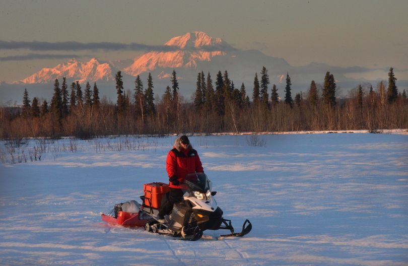 Josh Rindal of Spokane pauses on the Yentna with Mount McKinley in the background on Day 1 -- Feb. 28, 2014 -- of his 1,400-mile snowmobile trip along Alaska's Iditarod Trail. He's traveling with Bob Jones of Kettle Falls, a veteran of 20 trips along the famous sled dog route. (Robert Jones)